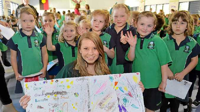 BOTTLING SUPPORT: Bindi Irwin meets some Prep students at Burnside State Primary School where she, Terri and Robert were thanking the school for raising $10,000 through the Get Back to Tap campaign.