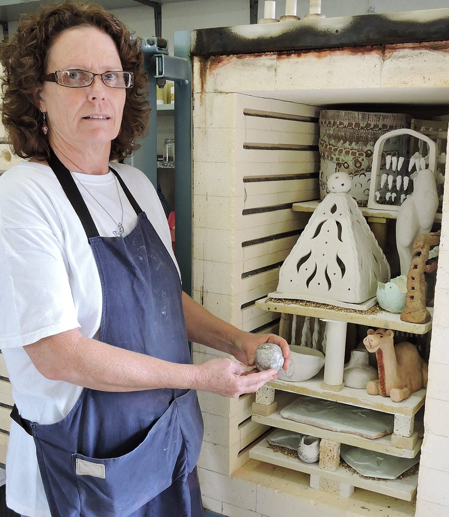READY TO FIRE: Sue Vickerman, president of Beach Potters in Yeppoon, checks the kiln before firing pottery at the open day on Saturday. Picture: MIKE KNOWLING / CAPRICORN COAST MIRROR