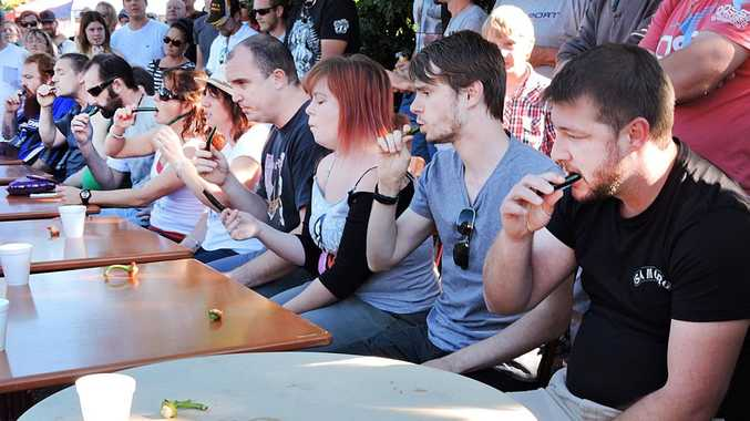 IRON CONSTITUTIONS: Brave contestants go to work enthusiastically but early in the chilli-eating competition. Photo Mike Knowling / Capricorn Coast Mirror