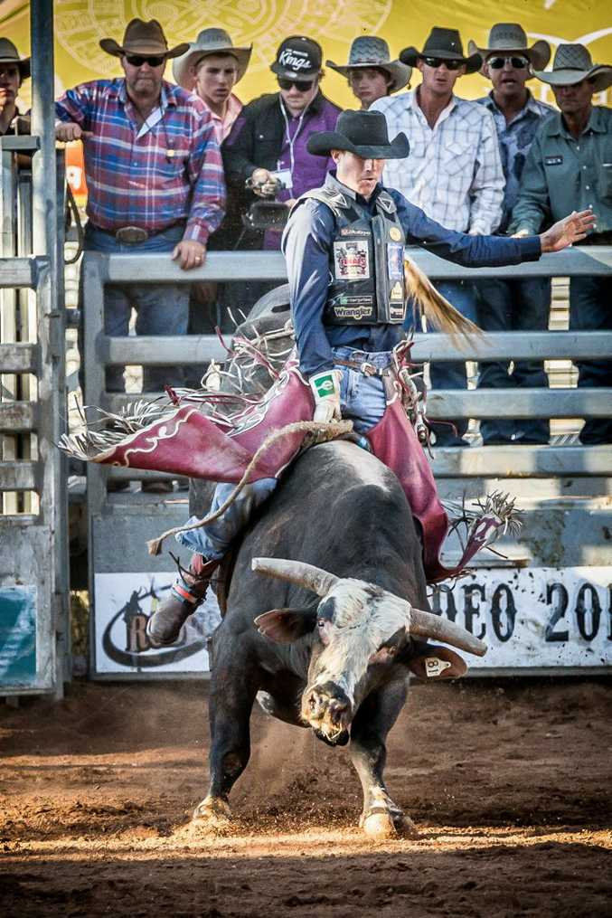 Ben Seeds at the 2013 Mount Isa Mines Rotary Rodeo riding Napoleon Dynamie, a bull supplied by stock contractor Darren Brandenburg.