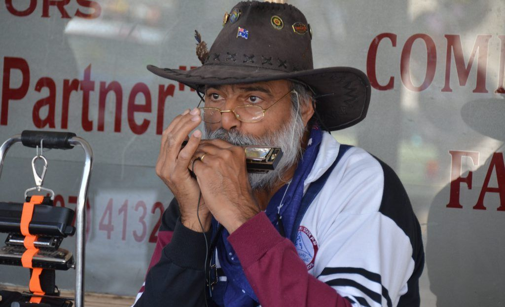 TOE-TAPPERS: Andrew Kumar delighted Gayndah shoppers as he played 'golden oldies' and folk tunes on his harmonica. Photo Shirley Way / Central & North Burnett Times