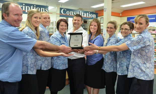 COMMUNITY FOCUS: Gayndah Guardian Pharmacy triumphed over 400 pharmacies to win the Community Engagement of the Year award. From left, Allen Walker, Samantha Shorten (Pharmacy Assistant finalist), Sam VanOosten, owners Samantha and Graham Rowles, Stephanie Tucker, Mandy Rae, Kristy Edwards and Leah Roth. Photo Shirley Way / Central & North Burnett Times