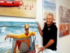 Rolf Sieber, president of Hervey Bay Art Society, with the artworks that will be judged at the society's Annual Competitive Art Exhibition held at the Hervey Bay Regional Gallery.