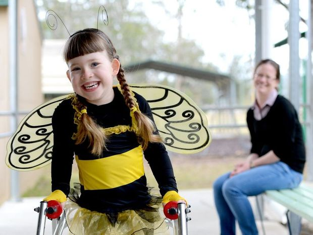 HAPPY GIRL: Lisa Innes watches daughter Caitlin who took part in a Book Week parade at her school at Walloon.