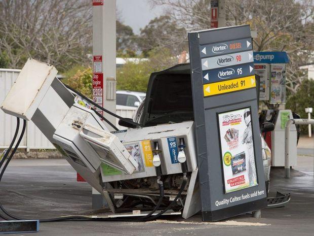 Car hits petrol bowser at Caltex Woolworths petrol station at Wilsonton.