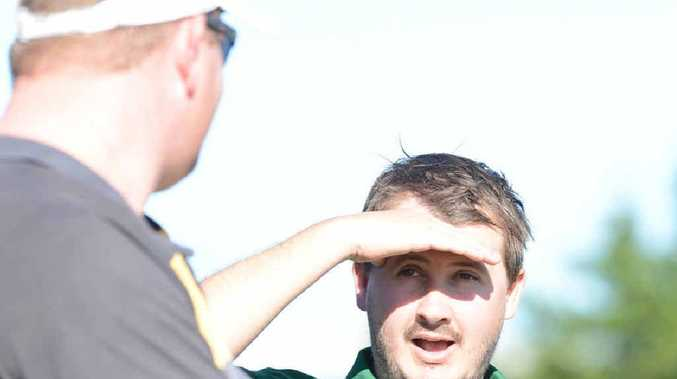 LOOKING AHEAD: Ipswich Knights coach Chris Brown chats to manager Paul Milne during a recent match at Bundamba.