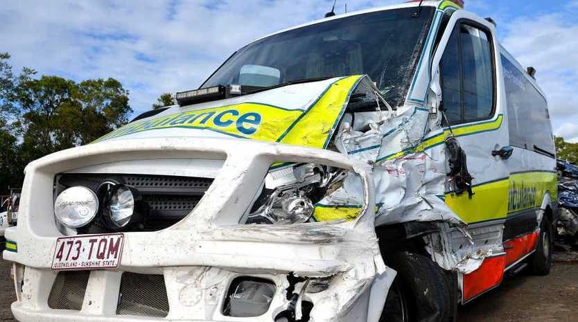 POWERFUL IMPACT: The ambulance looks worse for wear after the crash on the Bruce Hwy.