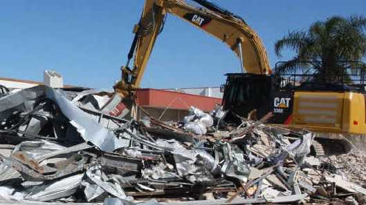 WORK DEFENDED: Commercial properties were demolished this week to make way for a new intersection.