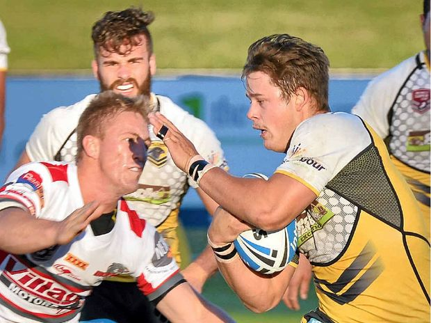 GREAT DAY: Brett Doherty makes a break for the Falcons against Redcliffe on July 12, as the Coast heads for its lone win of the season to date.