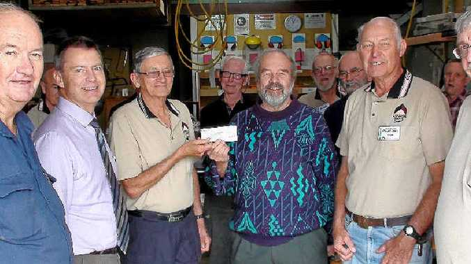 KIND DONATION: Coolum Men's Shed members present John Williams of QMSA with the money raised.