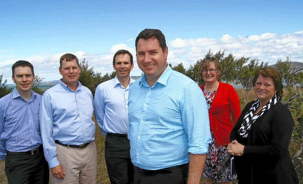 ISLAND SAVIOURS: Environment Minister Andrew Powell (third from right) with (from left) LNG representatives Ben Power, Page Maxson, Brenton Hawtin and Tracey Winters, and Gladstone MP Liz Cunningham.