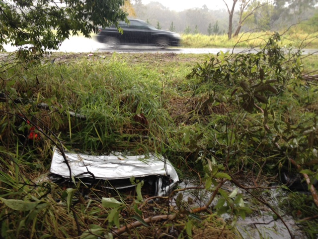 Remnants of last night's car crash at Glenview, where a mother and two of her children died.
