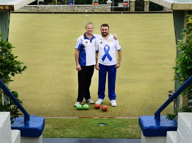 SPECIAL GAME: Chris Thomas (right) and Ipswich Bowls Club member Daniel Knight take a break in their game.