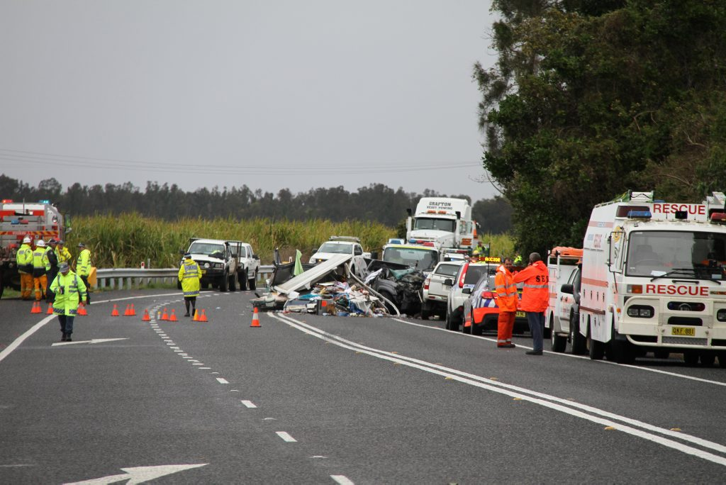 Two people were killed and five others were taken to hospital after a horror crash involving a truck and two cars on the Pacific Highway north of Woodburn.