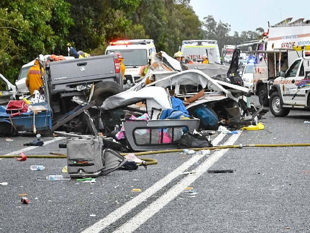 CRASH ZONE: Debris litters the Pacific Highway near Woodburn after Saturday's fatal crash.