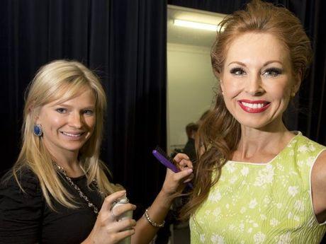 Bronte Antonio puts the finishing touches to model Katrina Perrin backstage.