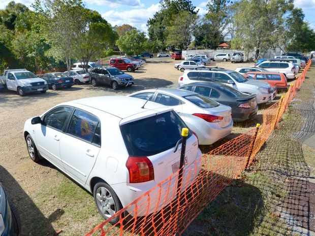 "Cars parked on the site of the old convenience store ""Top Shop"" across the road from the Rockhampton Hospital. Photo: Chris Ison / The Morning Bulletin"