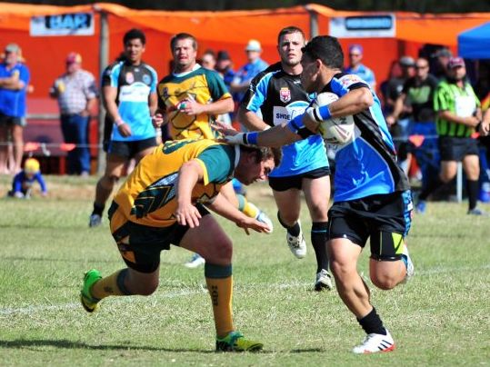 GREAT RUN: Gin Gin's Matthew Card goes low to stop South Kolan fullback Feingaola Blake in the NDRL preliminary final at Agnes Water. Photo: Ben Turnbull / NewsMail