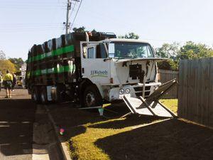 Woman hurt as dump truck hits car
