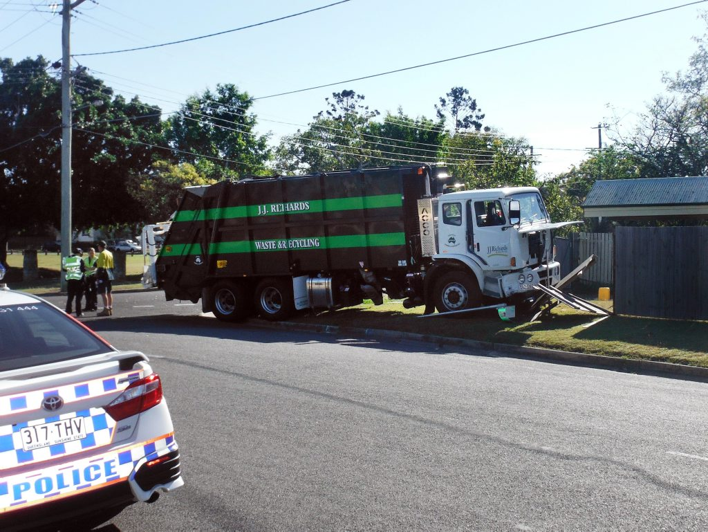 Garbage truck crashed into a fence are from a crash between the garbage truck and a sedan at the intersection of Challinor St and Cribb St, Sadliers Crossing, about 8.30am this morning. Photo Andrew Korner / The Queensland Times