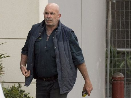 Alleged Bandidos motorcycle club participant Darryl Raymond Johns, 47, leaves Toowoomba Watchhouse after being granted bail on drug and weapon offences.