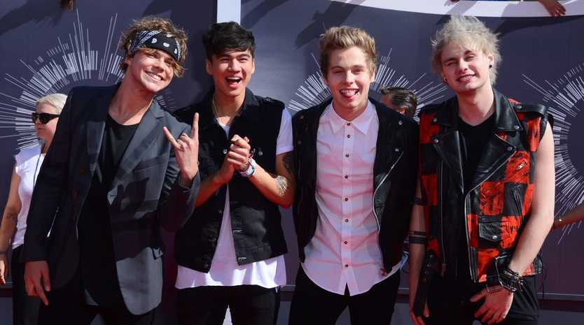 Ashton Irwin, from left, Calum Hood, Luke Hemmings and Michael Clifford of 5 Seconds of Summer arrive at the MTV Video Music Awards at The Forum in Inglewood, California.