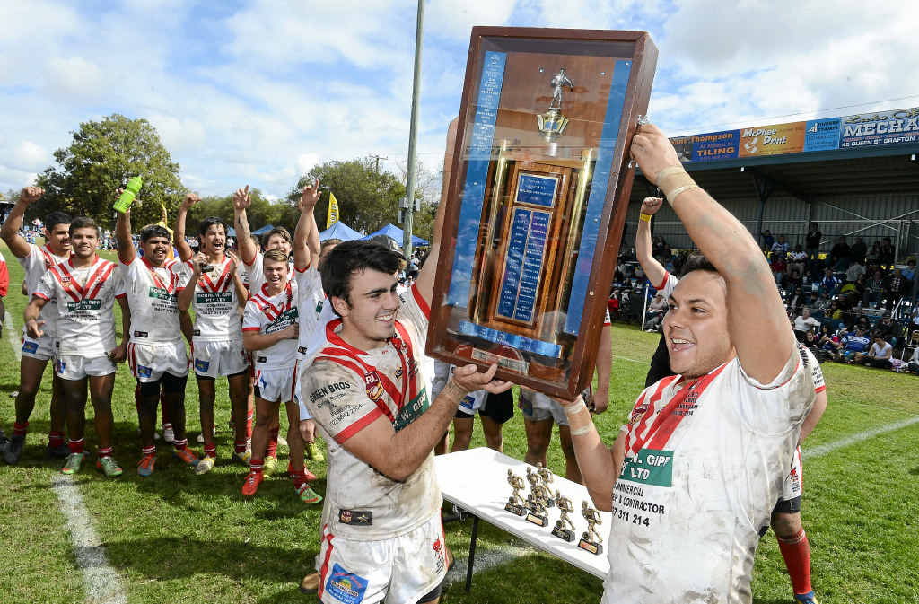 CHAMPIONS: Mason Graham and Matt Laurie lift the Group 2 under-18s shield for the South Grafton Rebels.