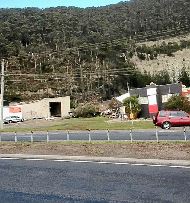 GONE: This pic of a blown-off roof at coastal Burnie beside Tasmania's Bass Highway was submitted by a driver.