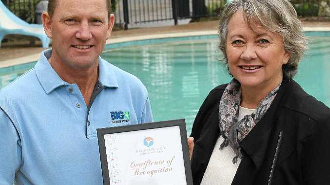 SAVINGS: BIG4 Ballina Headlands Holiday Park owner Graeme Gray (left) has saved $16,000 in five years with water-saving upgrades. Rous Water chair Sue Meehan (right) awards him a bronze level certificate of the Sustainable Water Partners program.