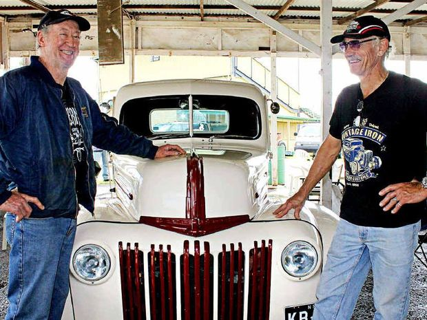 GOOD TIMES: Borderline Street Rodders members Kevin Boyd, left, and Peter Nielsen at their club's swap meet at the Lismore Showgrounds at the weekend. They are pictured with Mr Boyd's 1946 Ford Freighter.