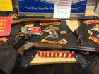Guns, drugs and clothing seized in bikie raid