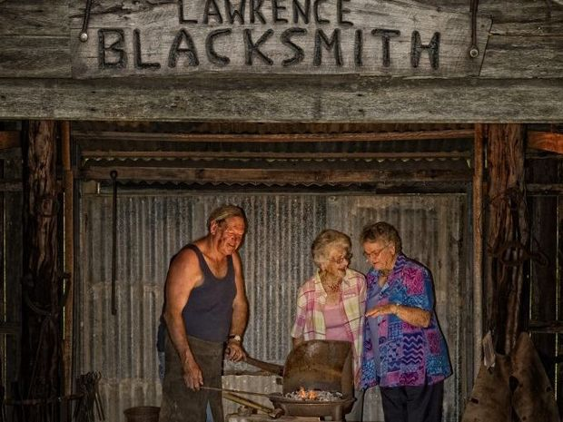 Blacksmith Eoin McSwan shows Lawrence Museum committee members Esther Smith and Rae Harrison around the new blacksmith shed to be opened at the Lawrence Museum on Saturday. Photo Adam Hourigan / The Daily Examiner
