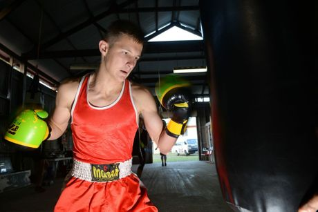 GOLDEN GLOVES: Bundaberg Boxing Club's Lochlan Turnbull won the Golden Gloves Boxing Tournament after beating Connor Welsh in the final bout. Photo: Max Fleet / NewsMail