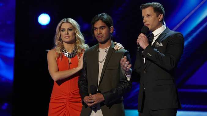 Sydney singer Adrien Nookadu, 17, pictured during his elimination from The X Factor with mentor Natalie Bassingthwaighte, left, and host Luke Jacobz.