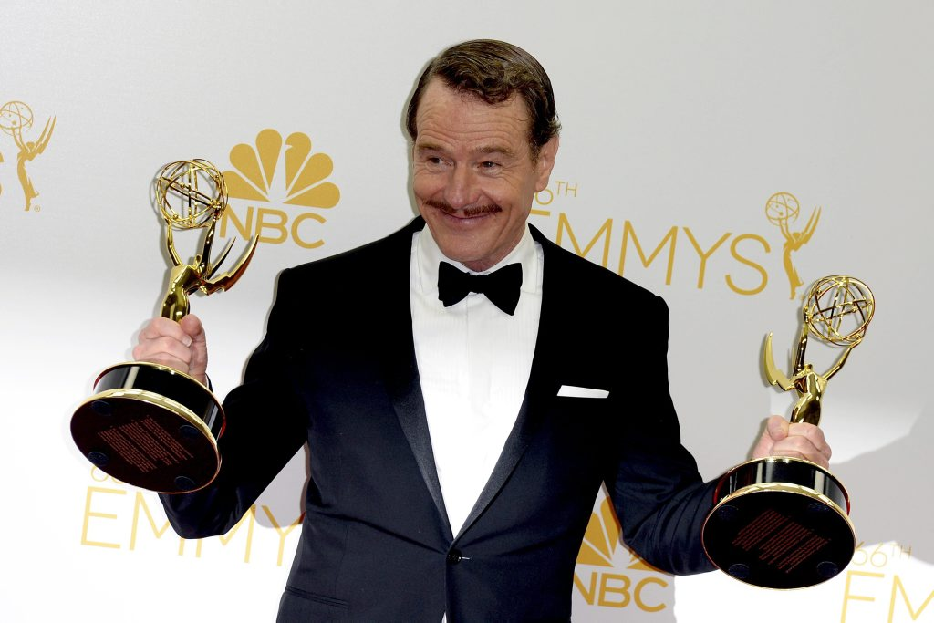 Bryan Cranston holds the Emmy Awards for Outstanding Lead Actor in a Drama Series and Outstanding Drama Series for Breaking Bad at the 66th annual Primetime Emmy Awards held at the Nokia Theatre in Los Angeles, California.