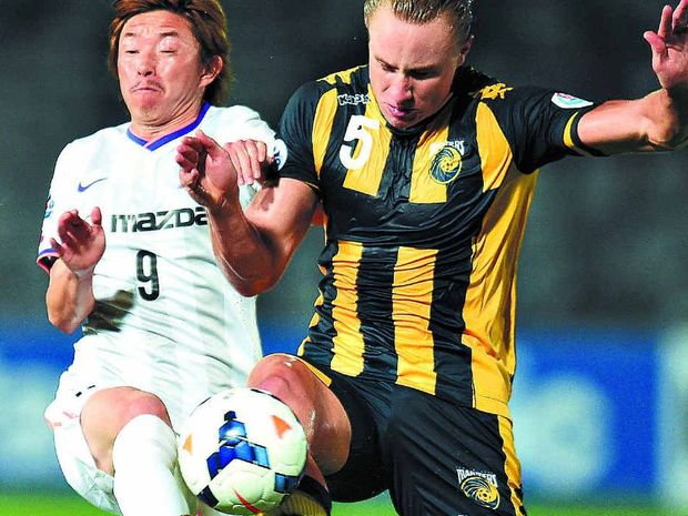 LEADERSHIP QUALITIES: Central Coast Mariners player Zac Anderson (right) competes for the ball against Ishihara Naoki of Sanfrecce Hiroshima during an AFC Champions League match at Bluetongue Stadium in Gosford in March.