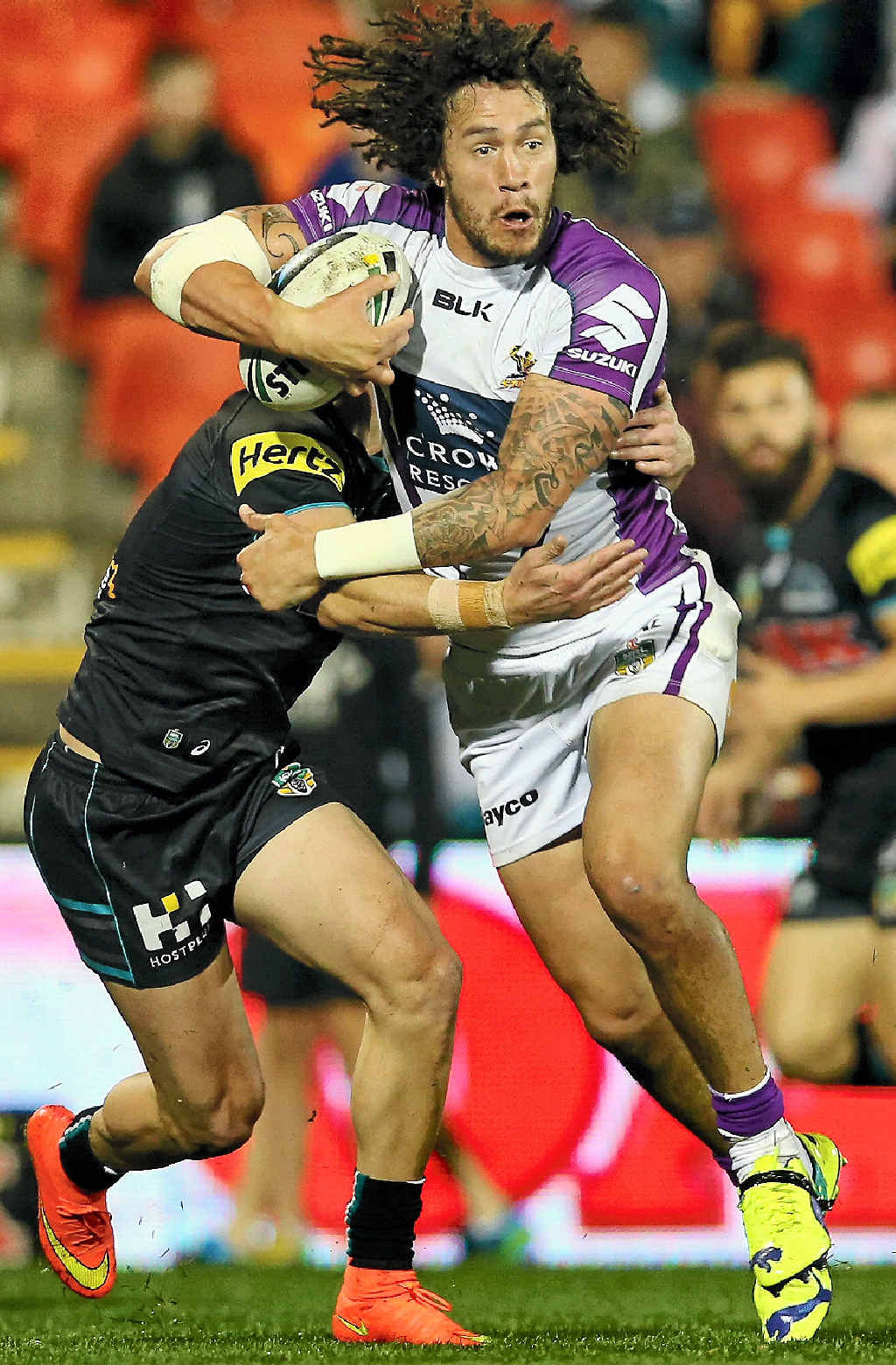 Kevin Proctor of the Storm on the run against the Penrith Panthers at Sportingbet Stadium in Sydney last night.
