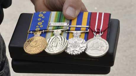 Ipswich police recovered approximately $40,000 worth of property believed stolen recently during burgularies across Yamanto. David Cussons who received his stolen war medals. Photo Inga Williams / The Queensland Times