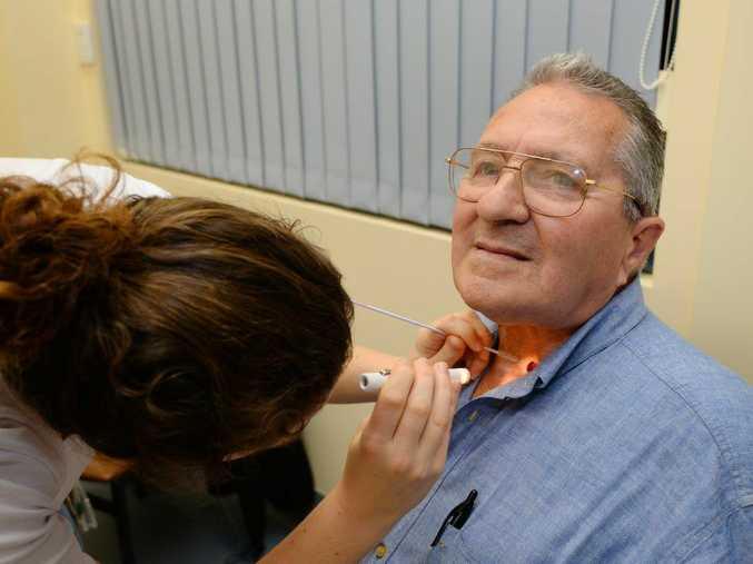 John Graham with his speech pathologist Claire Lane at the Rockhampton Hospital. Photo: Chris Ison / The Morning Bulletin