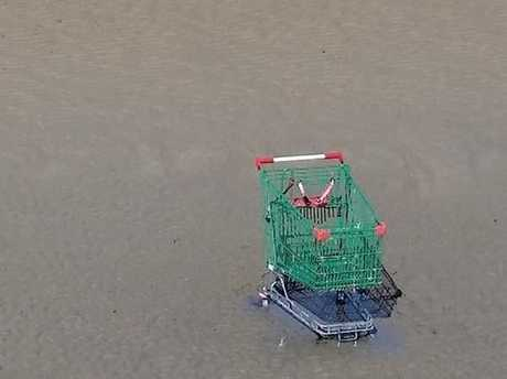 An abandoned shopping trolley can be seen from the Urangan Pier.
