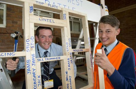 Ryan Stockley (left) and Adam Luck from Toowoomba Christian College look into the building trade at USQ.