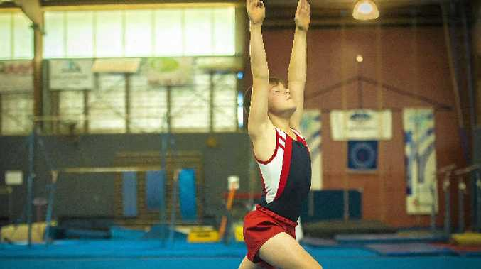 TOP EFFORT: Haish McDonald balances after a pass during the CQ Junior Regional Championships at the Gladstone Gymnastic Club.