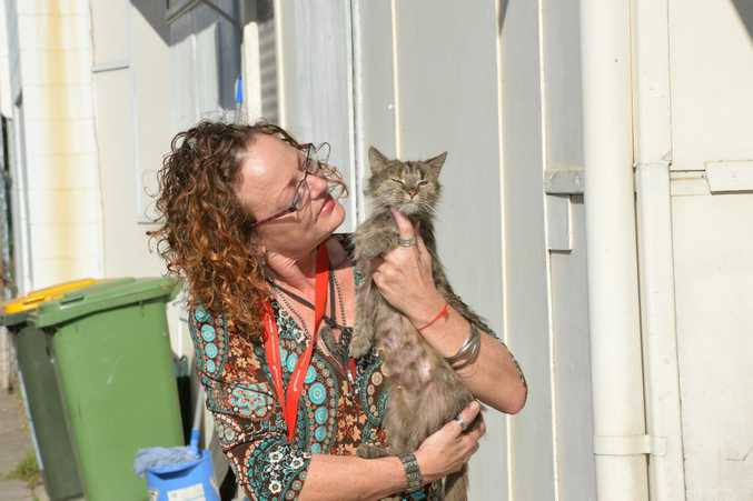 Leanne Jones with one of the feral cats.