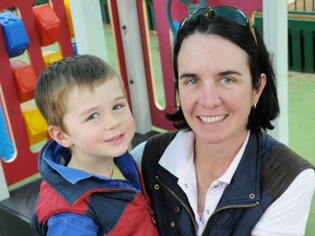 Four-year-old Rob Rindfleish and mum Betty get out in the playground at Toowoomba's AEIOU centre.