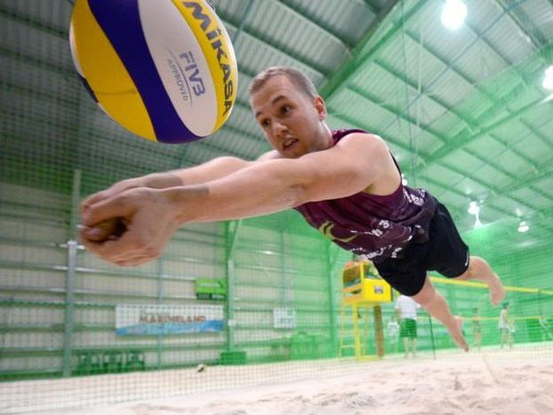 STATE TITLES: Daniel Facier gets in some training ahead of the State Indoor Beach Volleyball Championships being held at Beach 365. Photo: Max Fleet / NewsMail