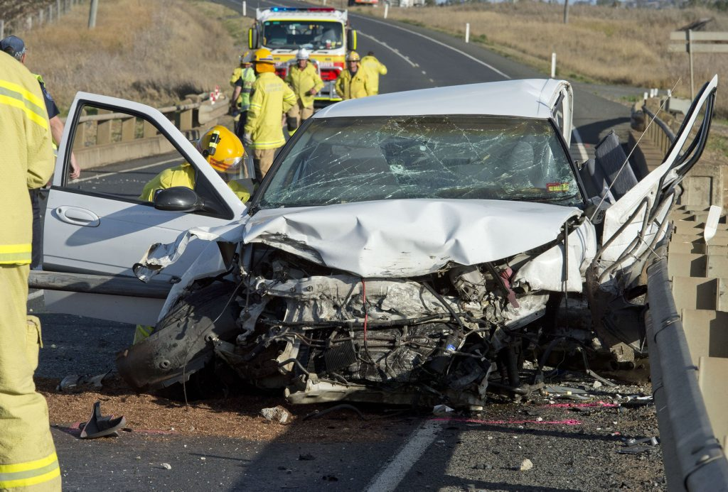 The Falcon sedan that crashed into a bridge on the New England Hwy.