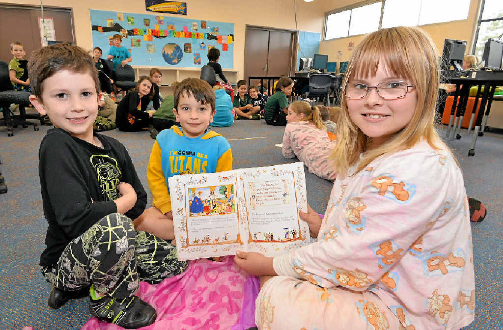 A GOOD READ: Xavier Creevy, Nate Harney and Fiona Peddell, of Childers State School, participated in Book Week.