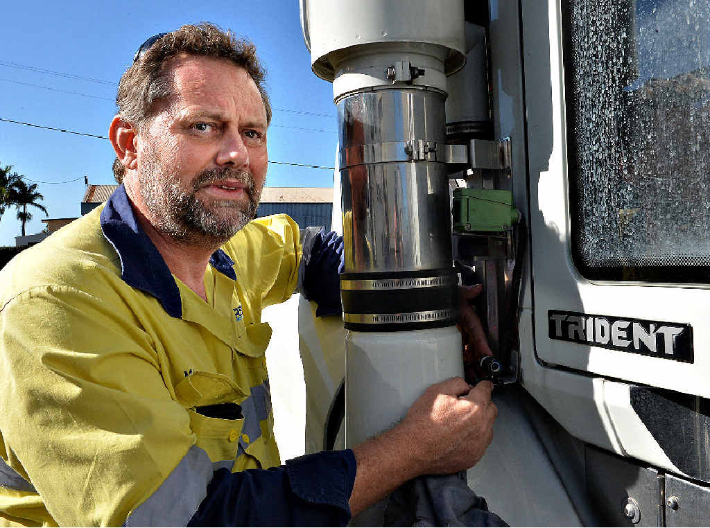 Zarb Road Transport safety facilitator Mark Lalor checks one of the company's truck-mounted video cameras.