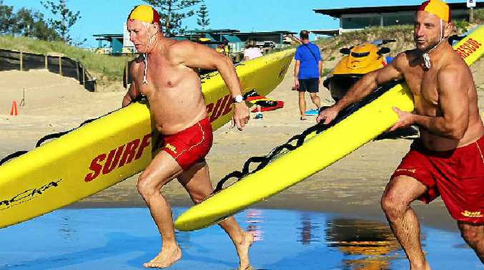 OPEN DAY: Marcoola Surf Club's Rob Jenkins and Darren Polla-Mounter head for the water.