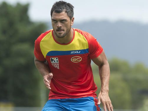Gold Coast Suns player Karmichael Hunt looks on during a training session on the Gold Coast, Tuesday, March 11, 2014.